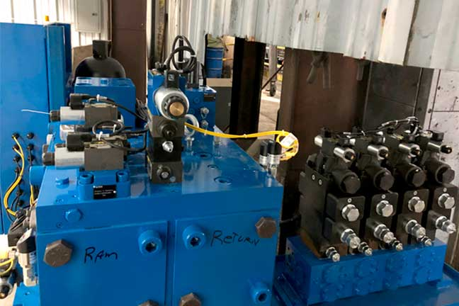 Blue forging parts ready for facility engineering services
